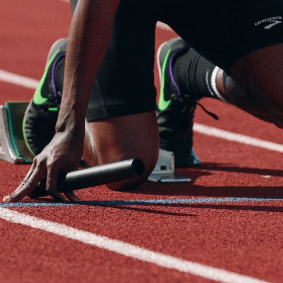Man ready for relay race to promote leading athletics insurance brokers Full-Time Cover