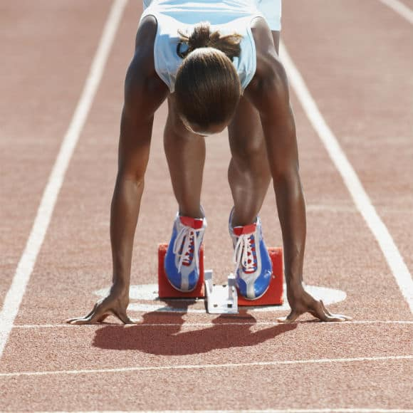 Female athlete ready for race to promote leading athletics insurance brokers Full-Time Cover