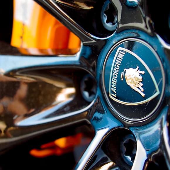 Lamborghini wheel plate to promote leading car insurance brokers Full-Time Cover