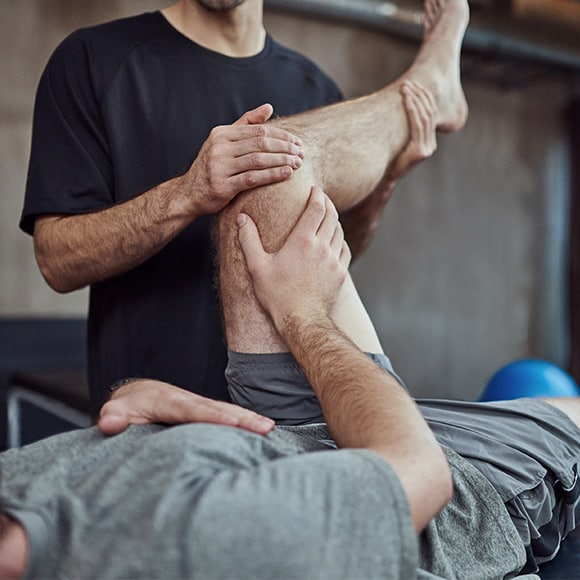 Man in physiotherapy session to promote leading career ending insurance broker Full-time Cover