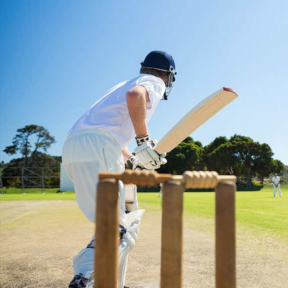 Cricketer on pitch to promote leading cricket insurance broker Full-time Cover