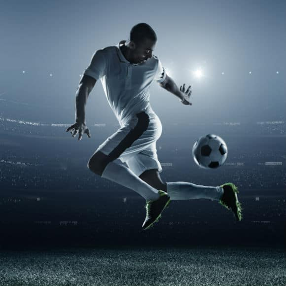 Stylized image of footballer managing ball on pitch to promote leading football insurance brokers Full-Time Cover