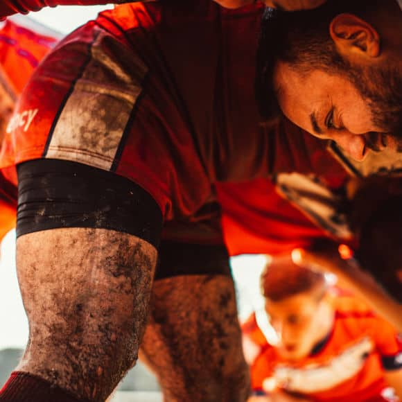 Rugby players in scrum to promote leading rugby insurance brokers Full-Time Cover