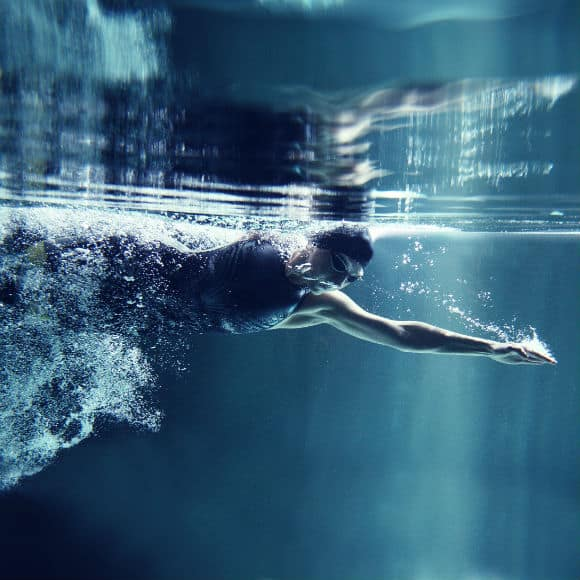 Swimmer in action to promote leading swimming insurance brokers Full-Time Cover