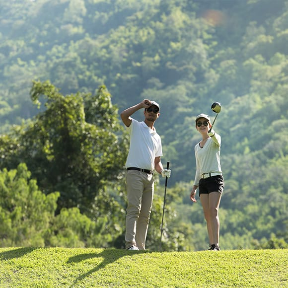 Two golfers watching golf ball soar through the skies to promote Full Time Cover's Amateur Golf Insurance