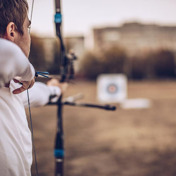 Male practicing archery to promote Full Time Cover's Sports Shooting Insurance